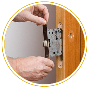 Handyman repairing a door handle